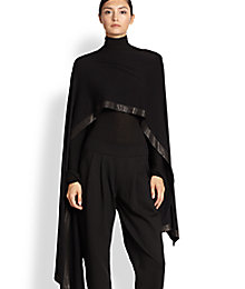 Donna Karan black leather trimmed cape.